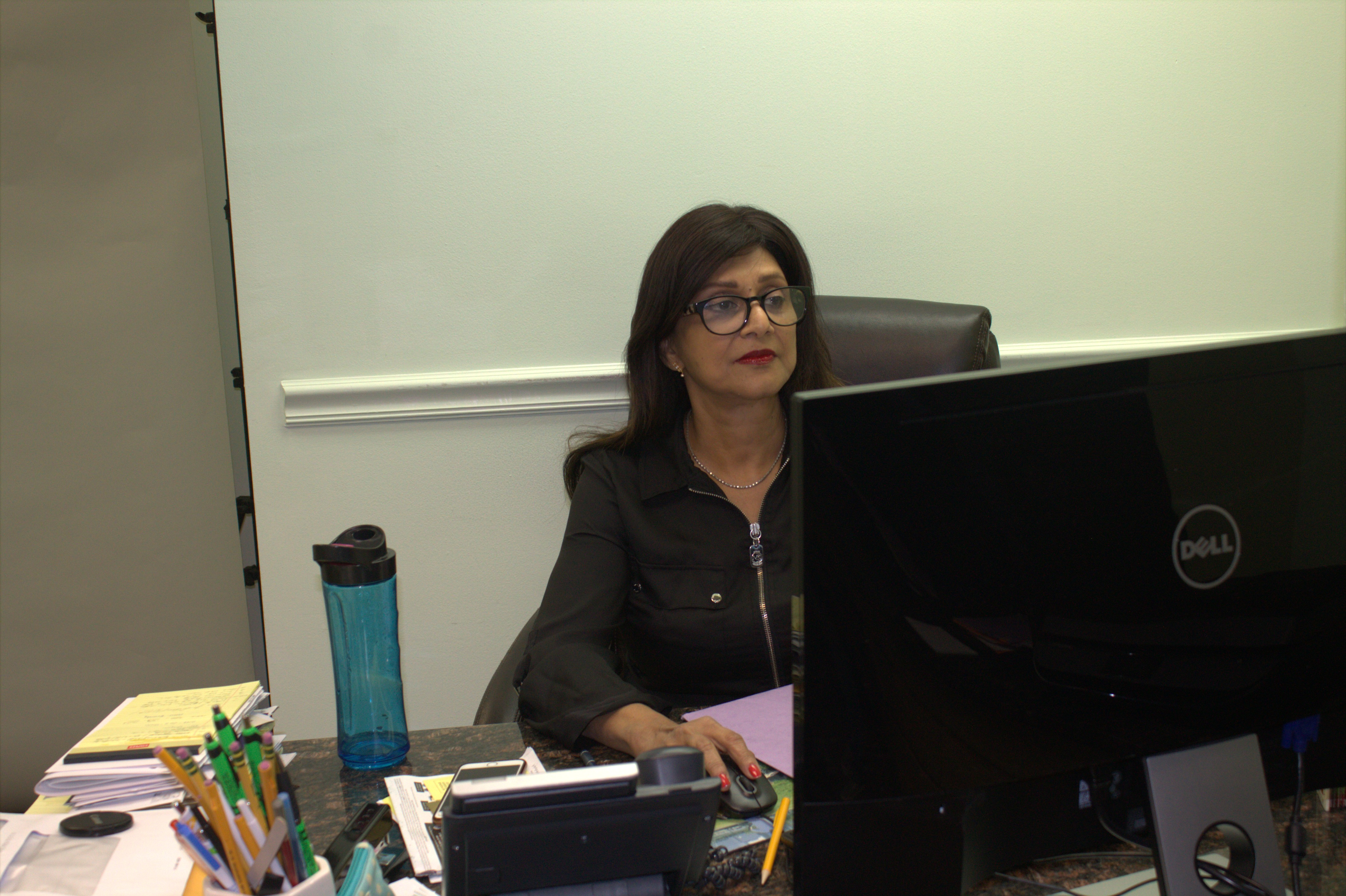 Dr. Baig at her desk